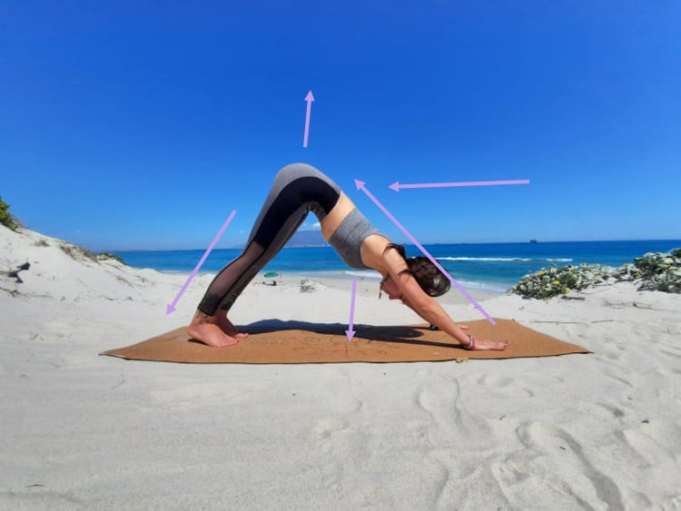 Downward dog how-to on the beach