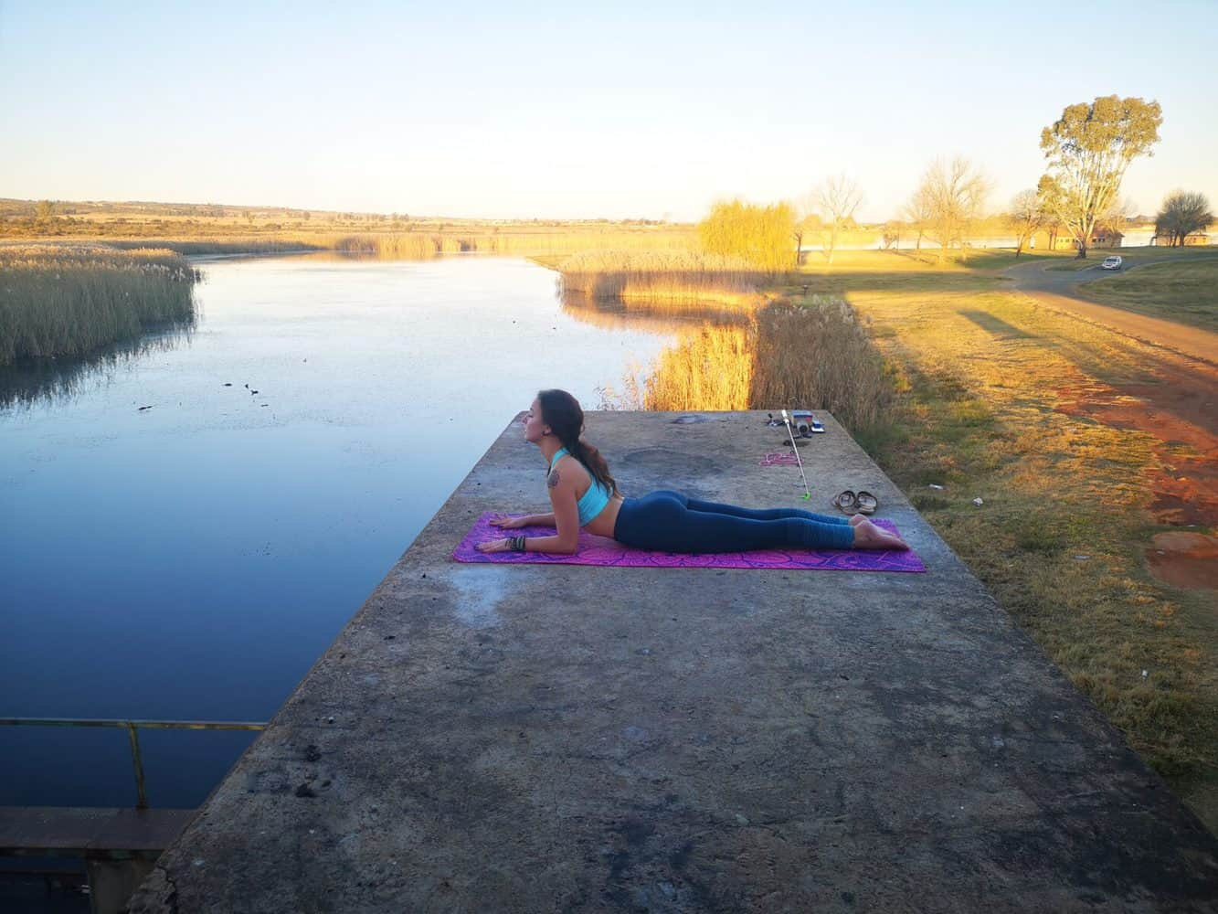 aiya yoga sphinx pose by the water